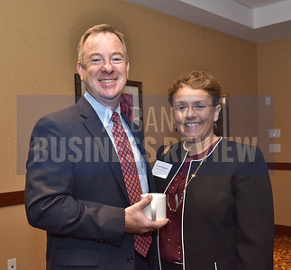 Chris Burke from the Northeastern Association of the Blind at Albany and Veronica Mangione from the Wealth Advisory Group