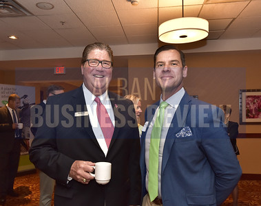 Frank Dyer from Pioneer Bank, left, and Andrew Halliday from Hugh Johnson Advisors