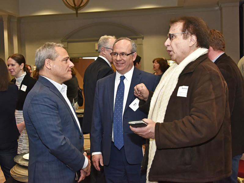 Dr. Thomas Caulfield, Mark Mitchell and Burhan Ozmat