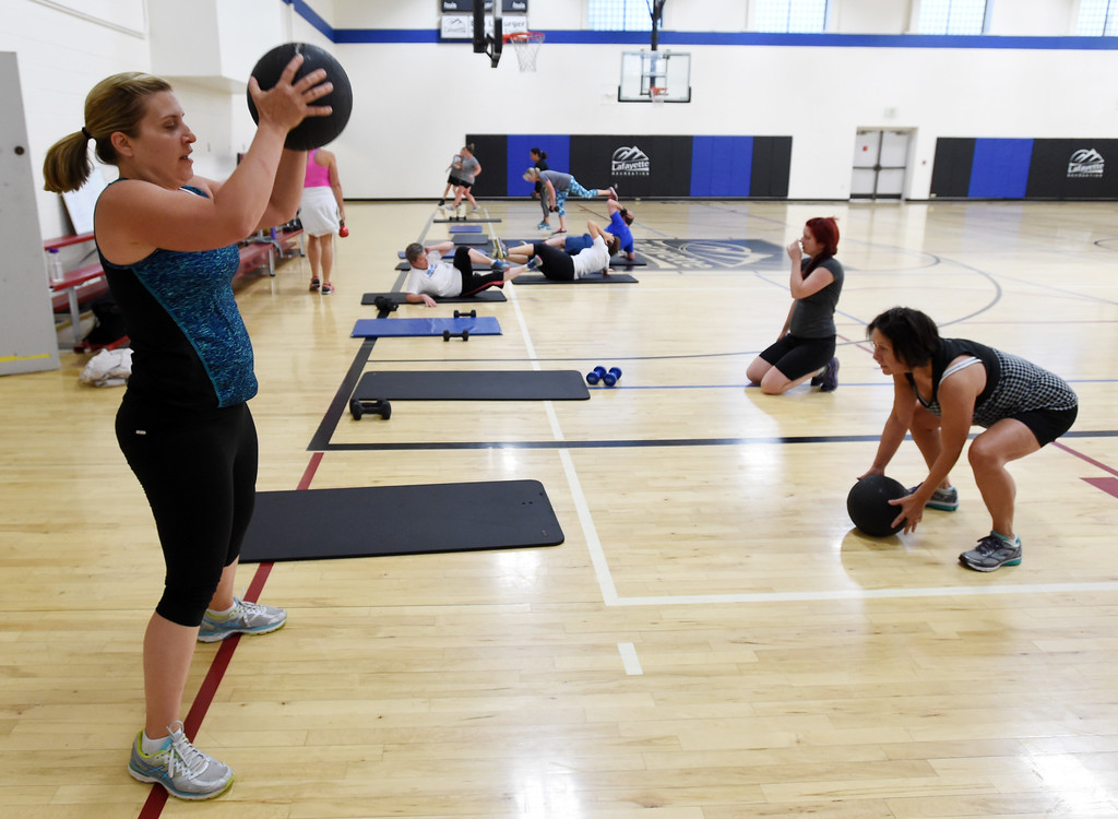 . Heidi Foote, left, is among the group doing the Power Fitness Friday workout.Heather Patik teaches the Power Fitness Friday workout at the Bob L. Berger Recreation Center in Lafayette.  Cliff Grassmick  Staff Photographer June 2, 2017