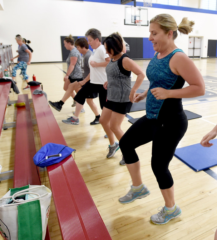 . Heidi Foote, right,  is among the group doing the Power Fitness Friday workout. Heather Patik teaches the Power Fitness Friday workout at the Bob L. Berger Recreation Center in Lafayette.  Cliff Grassmick  Staff Photographer June 2, 2017