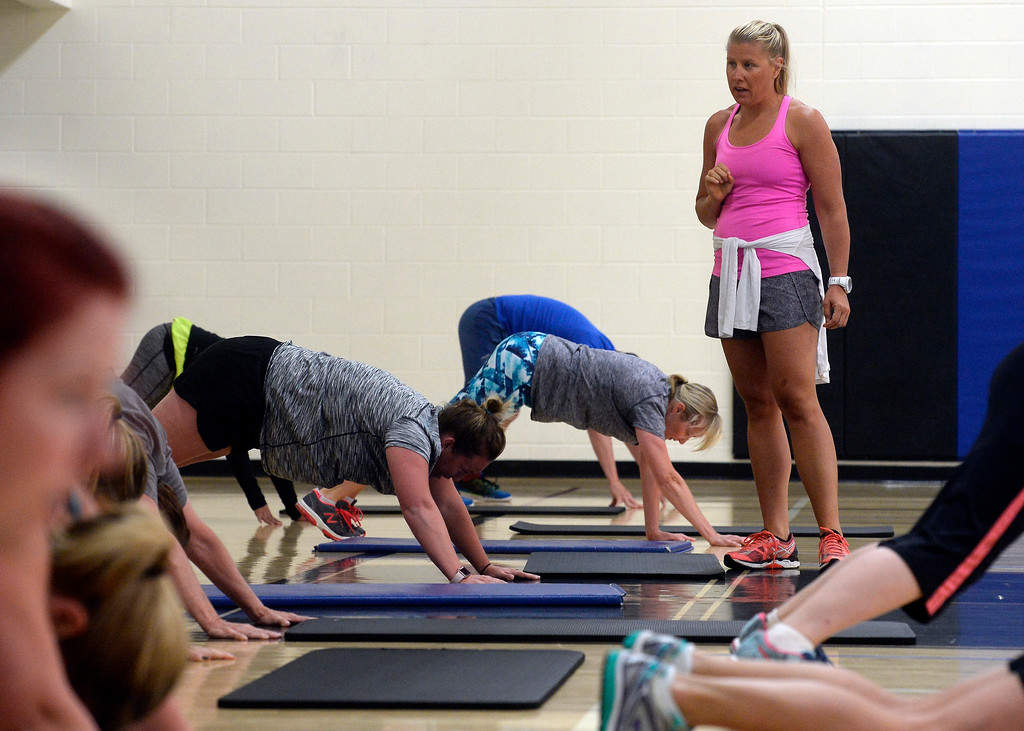 . Heather Patik, right,  teaches the Power Fitness Friday workout at the Bob L. Berger Recreation Center in Lafayette.  Cliff Grassmick  Staff Photographer June 2, 2017