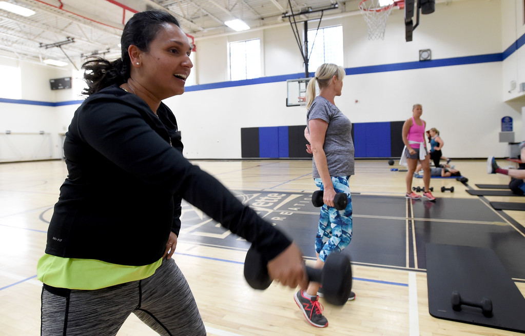 . Natasha Wright, left, is among the group doing the Power Fitness Friday workout. Heather Patik teaches the Power Fitness Friday workout at the Bob L. Berger Recreation Center in Lafayette.  Cliff Grassmick  Staff Photographer June 2, 2017