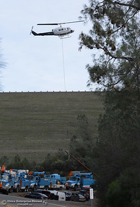 PG&E crews remove towers along the Diversion Pool to reroute transmission lines Wednesday, Feb. 22, 2017, in Oroville , California. (Dan Reidel -- Enterprise-Record)
