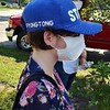 """Jessica Wheeler, president of the Greater Lowell Veterans Council's volunteer corps, sports a hat that says """"Pyong tong,"""" which translates as """"Peaceful unification."""""""