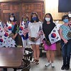 Members of the South Korean Boston Chapter of the National Unification Advisory Council, including Yong Lee, center, the vice president, and the Greater Lowell Veterans Council gather at Dracut VFW Post 315 to assemble flags and carnations.