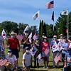 Volunteers prepare to put carnations on the grave markers of Korean War veterans.