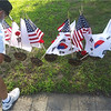 Jean Pinard of Lowell admires flags and carnations at one grave marker.