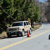 A car drives under downed utility lines at the intersection of Middle Road and Kipling Road, in Dummerston, on Thursday, April 5, 2018. Brattleboro Assistant Fire Chief Lenny Howard said that wires may appear to be not live, but someone backfeeding from their house by a generator or solar power could make the line active. The chief said motorists should always treat a powerline like it's live until a representative from the power company arrives. If a car hits the line, you never know the voltage going through the line.