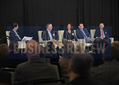 Senior reporter and moderator Michael DeMasi, left, with panelists David Apkarian, president and CEO of TransTech Systems; Denise Gonick, president and CEO of MVP Health Care; Mike Elmendorf, president and CEO of Associated General Contractors of New York State; and Dan Nolan, president and CEO of Hugh Johnson Advisors.