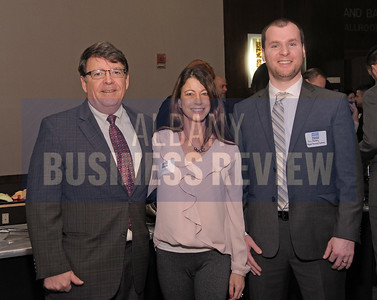 Michael Tucker from Tucker Strategies, left, with Dawn Abbuhl and Cory Manning from Repeat Business Systems.