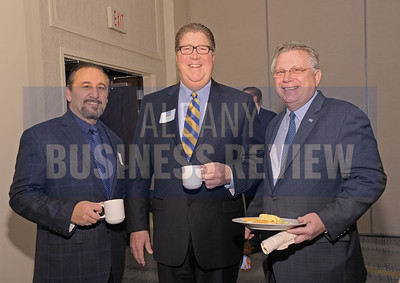 Michael Lang of Lang Media Properties, left, with Frank Dyer of Pioneer Bank and Howard Foote from UHY.