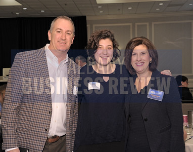 Denise Gonick, president and CEO of MVP Health Care, right, with her family Steve and Katie Gonick.