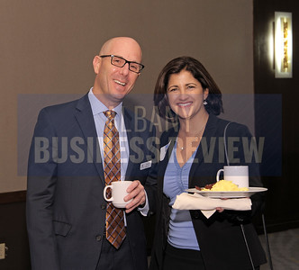 David Hollander, president of Sano-Rubin Construction Services with Georgia Kelly of Merrill Lynch.