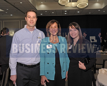 Adam Blot from TransTech Systems, left, with Roberta Bastow from KeyBank and Lauren Payne from Spiral Design.