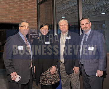 Lawrence Knapek of Knapek, Gabriele & Bottini, left, with M. Tracey Brooks of Featherstonhaugh, Wiley & Clyne, Alexander Mathes of Mathes Public Affairs, and Mark Westcott of Wescott Marketing.