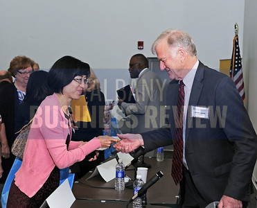 6-24-2015, Albany Business Review's Higher Education Power Breakfast.  Dawn Chen of the US-SINO Center with panelist Anthony Collins, president of Clarkson University.