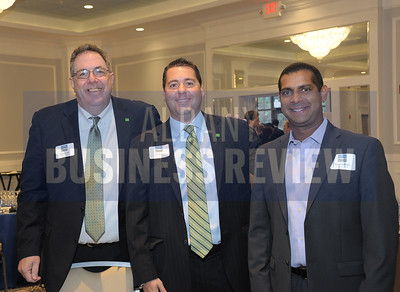 left, Bob Silvestri and Pier Bruno form TD Bank, with Niladri Ghoshal from Polyset Company.