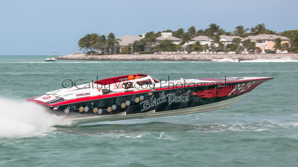 Black Pearl racing at the 2013 SBI Superboat International Offshore Powerboat World Championships at Key West, Florida, USA. Cathy Vercoe LuvMyBoat.com