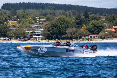 Speedy 1 charges past at the first race of the 2013 New Zealand Offshore Powerboat Racing season on Lake Taupo. Cathy Vercoe LuvMyBoat.com