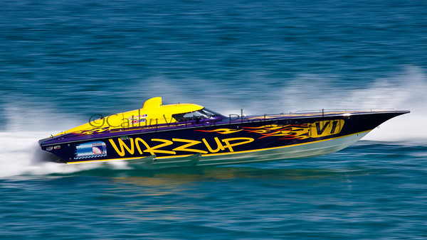 Wazzup at the 2012  OPA Palm Beach Offshore Powerboat World Championship held at Juno Beach, Jupiter, Florida USA.. Cathy Vercoe