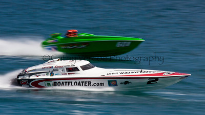 Boat Floater and Wazzup II at the 2012  OPA Palm Beach Offshore Powerboat World Championship held at Juno Beach, Jupiter, Florida USA.. Cathy Vercoe