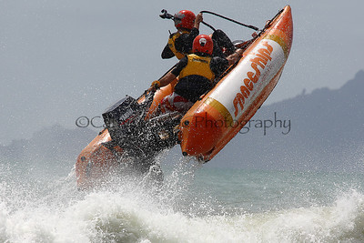 Spaceships leaps out of the water over a wave at the Thundercat NZ Surfcross Nationals at Waipu Cove 2011