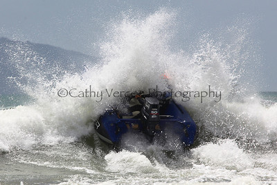 Boat Category: Smuggler crashes through a wave at the Thundercat NZ Surfcross Nationals at Waipu Cove 2011.
