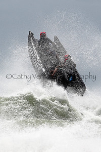 Onehunga Panel and Paint leaps off a wave at the Thundercat NZ Surfcross Nationals at Waipu Cove in 2011
