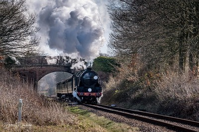 SR Maunsell S15-class No.847 passes under the bridge at Freshfield