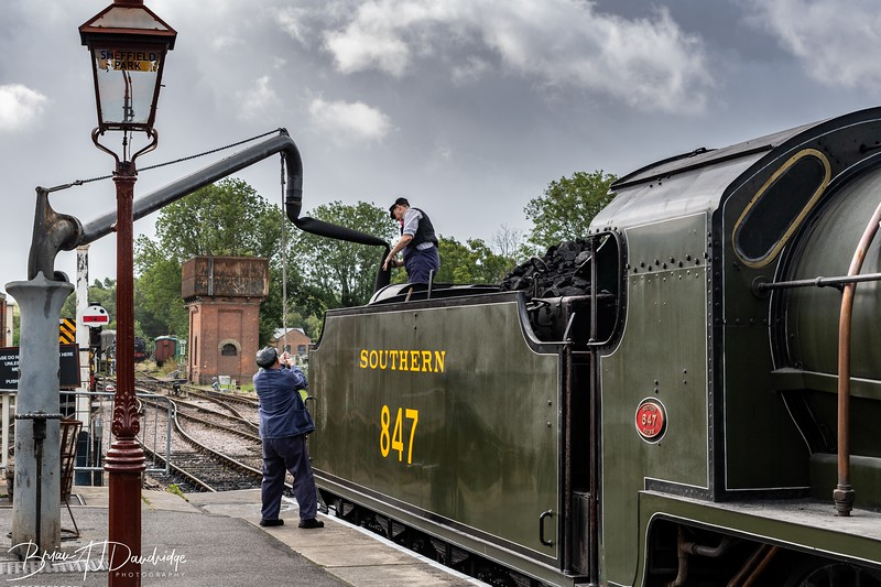Maunsell S15-class 4-6-0 No.847 takes on water