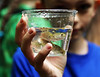 HOLLY PELCZYNSKI - BENNINGTON BANNER 5th grader Elijah Amidon holds a cup of three trout raised in the classroom of Pownal Elementary School throughout the winter. The trout after bening raised were released in Broad Book in Pownal Vermont.