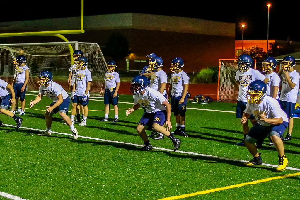 . The South Lyon Lions started their football season at midnight on Monday with a practice in the Jungle. (Oakland Press photo by Timothy Arrick