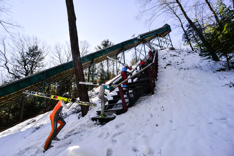 KRISTOPHER RADDER — BRATTLEBORO REFORMER<br /> Jumpers go up a flight of stairs as they make it to the top of the inrun at the Harris Hill Ski Jump, in Brattleboro, Vt., on Friday, Feb. 14, 2020.