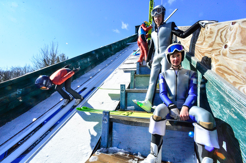 KRISTOPHER RADDER — BRATTLEBORO REFORMER<br /> Tobi Kerschhaggl and Simon Viehhauser, from Austria, examine the Harris Hill Ski Jump, in Brattleboro, Vt., as a jumper goes down the inrun on Friday, Feb. 14, 2020.
