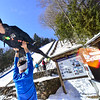 KRISTOPHER RADDER — BRATTLEBORO REFORMER<br /> Niklas Malacinski, from Steamboat, Colo., leaps into the arms of his coach, Karl Denney, while practicing his form before going down the Harris Hill Ski Jump, in Brattleboro, Vt., on Friday, Feb. 14, 2020.
