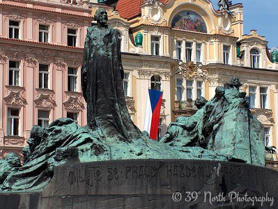 Statue of Jan Hus in Old Town Square. Jan Hus was a  Catholic priest, philosopher, and reformer who was burned at the stake for his heretical views on ecclesiology.
