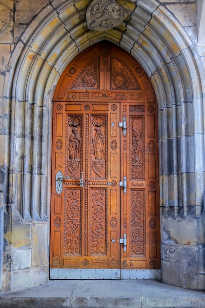 Amazing carving on wooden door of St. Vitus Cathedral. Click on image, click on the 3 overlapping boxes, and select largest size (ipad Retina x4) to appreciate it.