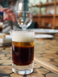 Beer shot - dark Master lager, Pilsner Urquell head, malt biscuit