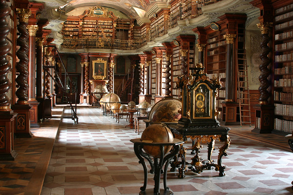 Probably my most favorite photo from Prague. This is the library at the Klementinum. Photos are generally not allowed here, but the tour guide gave me a few minutes to setup my tripod and snap a few shots quickly.   The Klementinum is a historical complex of buildings, that at one time was the third largest Jesuit college in the world. This library remains largely untouched from hundreds of years ago and is a classic example of baroque architecture which started in the early 17th century.