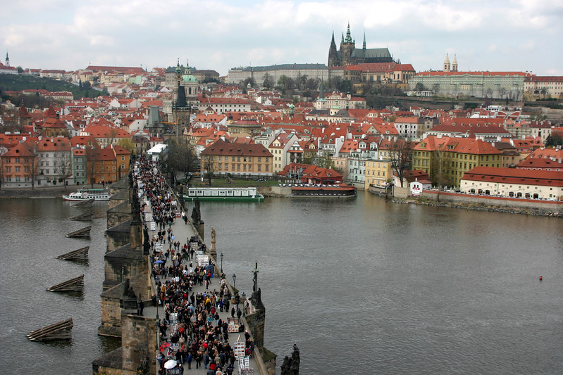 The Charles Bridge is always busy with visitors and tourists. You can see the Prague castle off in the distance across the Vtlava River.