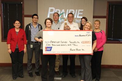 PPE 11-19-15 Cancer fund raiser check