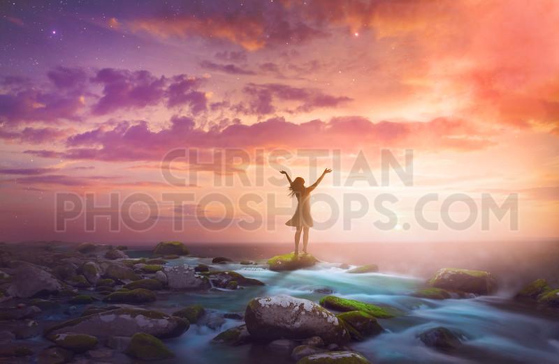 Woman praising at sunrise