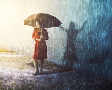 Woman in rain storm with shadow