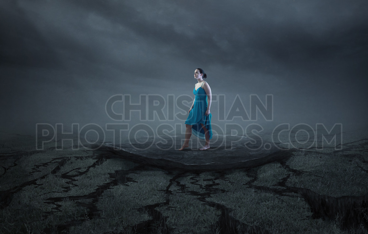 A woman stands on a solid rock