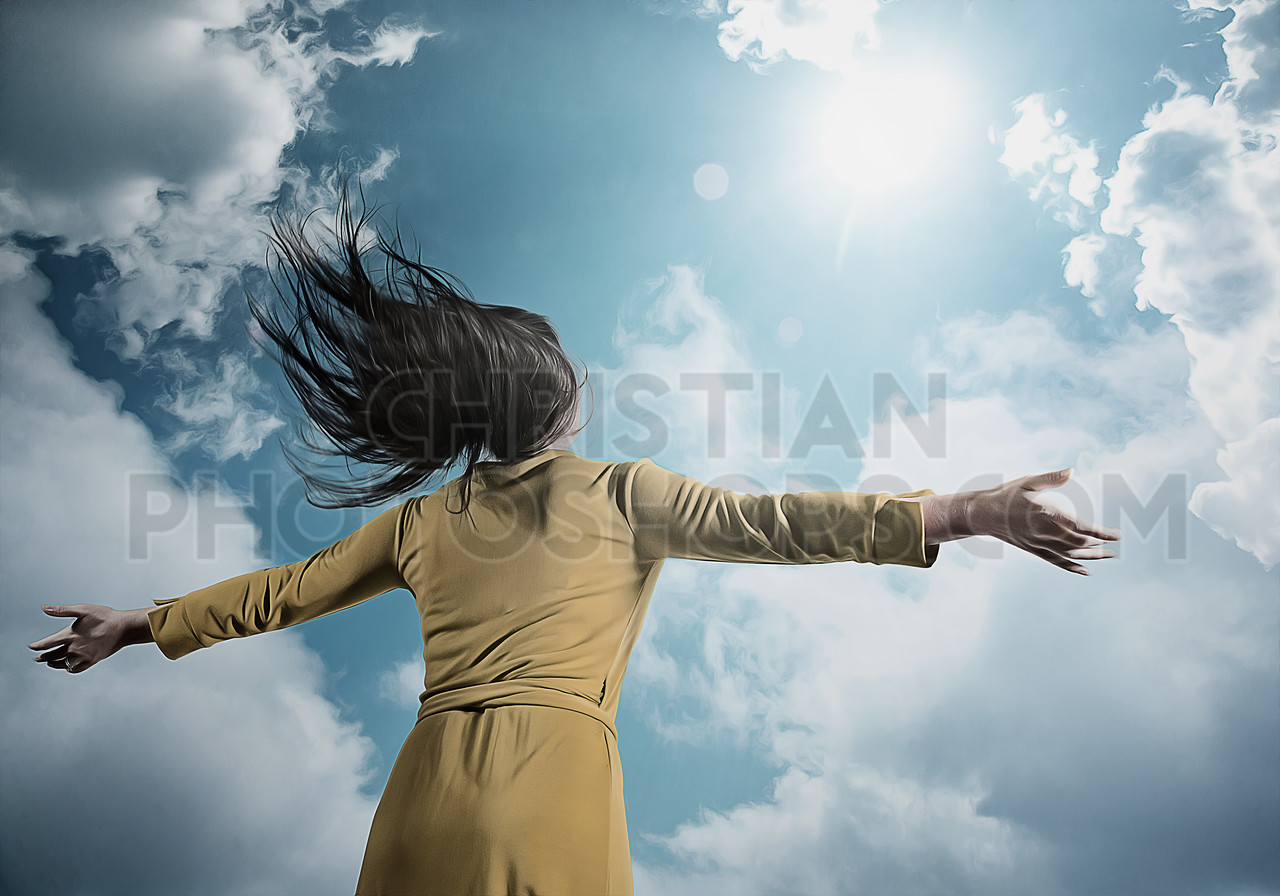 Woman looks up to heaven