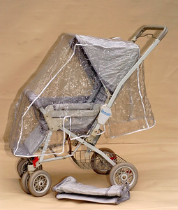 1986 Steelcraft 'Out & About' stroller with the original fitted raincover.