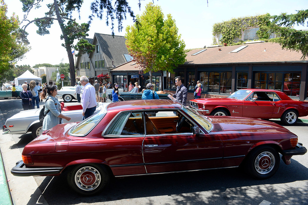 . People enjoy looking at the classic cars at the Prancing Ponies All Women Car Show in Carmel on Wednesday, Aug. 16, 2017.   (Vern Fisher - Monterey Herald)