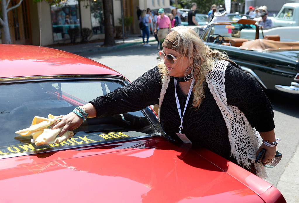 . Dia Rianda from Carmel cleans her 1968 Ford Mustang at the Prancing Ponies All Women Car Show in Carmel on Wednesday, Aug. 16, 2017.   (Vern Fisher - Monterey Herald)