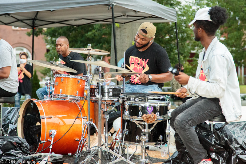 A band plays at a park in honor of pray on MLK.